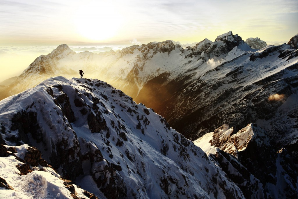 Alpinist-crossing-the-mountain-ridge-at-sunset-Dan-Briski